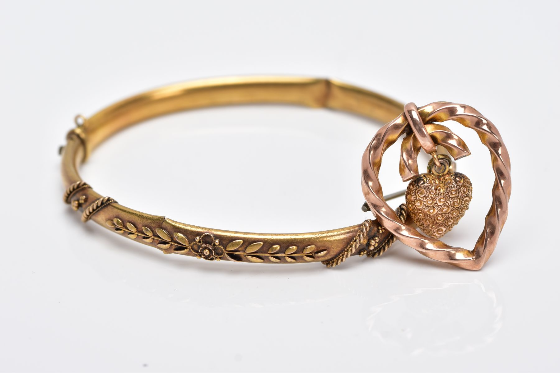 A LATE VICTORIAN BANGLE AND BROOCH, the AF hinged bangle with applied floral and bead design,