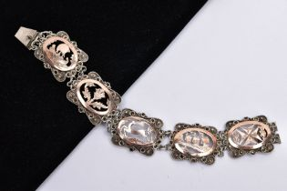 A WHITE METAL AND ROSE GOLD TONE BRACELET, designed with five openwork links, set with rose gold