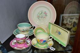 CLARICE CLIFF, comprising a Crocus pattern tea cup and saucer, backstamps for Royal Staffordshire