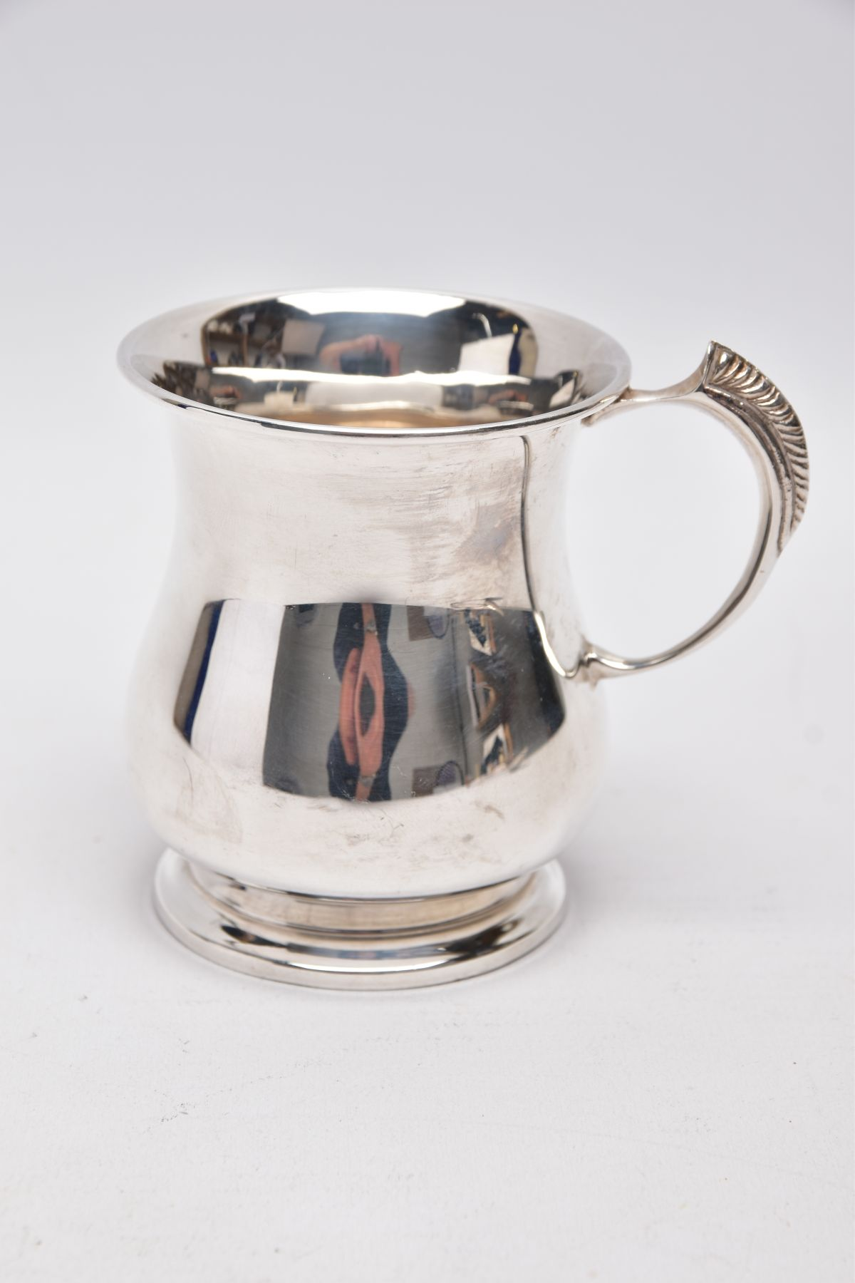 A SILVER TANKARD, bell shaped body with a feather detailed handle, hallmarked 'Roberts & Dore' - Image 2 of 5