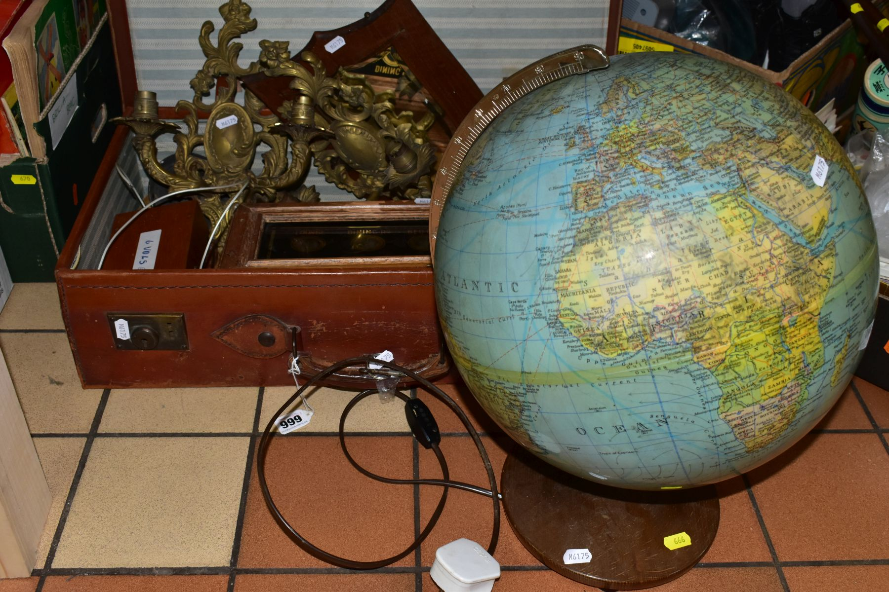 A BROWN LEATHER COVERED SUITCASE OF COLLECTABLES including servants bell board, etc, and a
