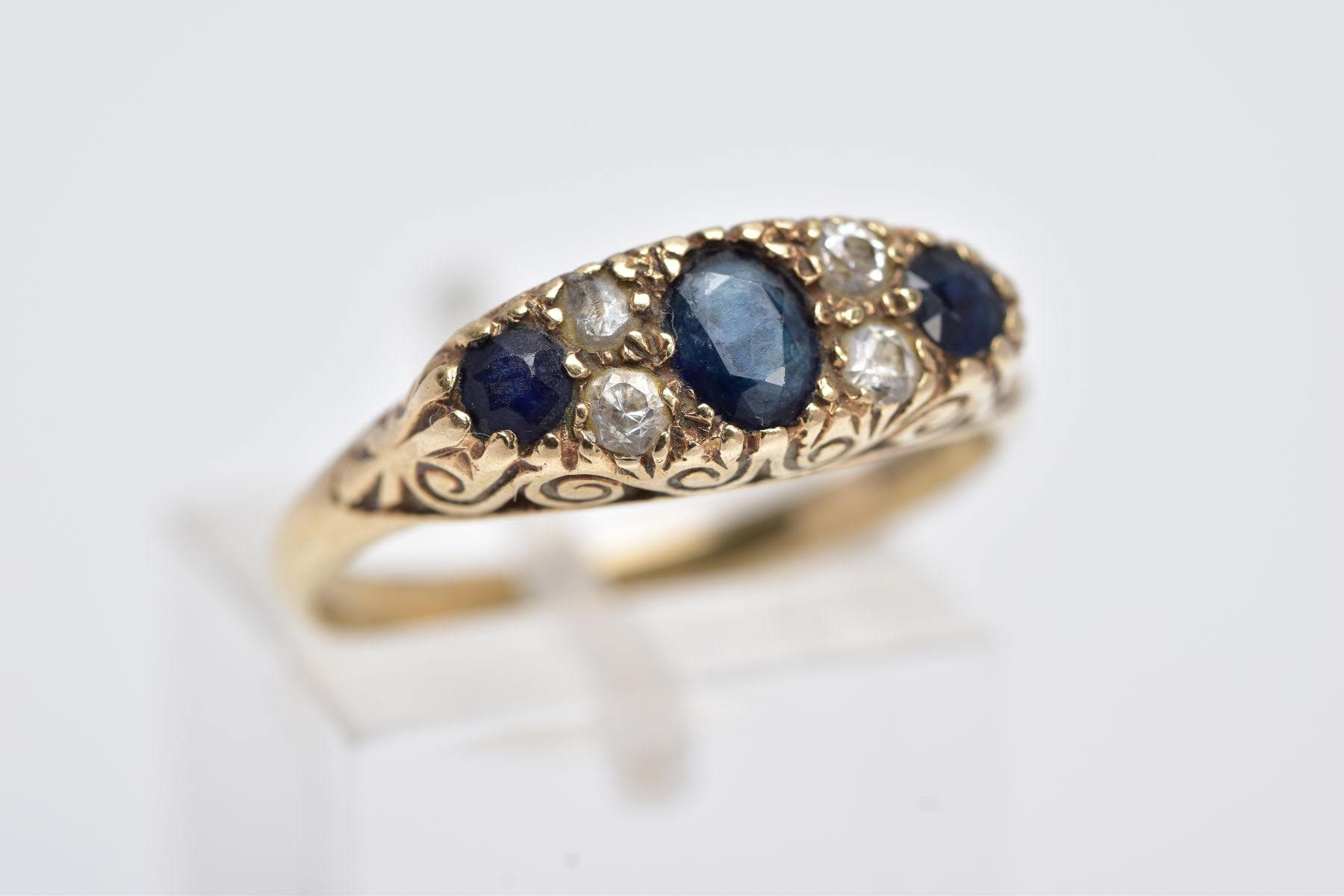 A 9CT GOLD SAPPPHIRE AND PASTE RING, centring on an oval cut blue sapphire flanked with colourless - Image 4 of 4