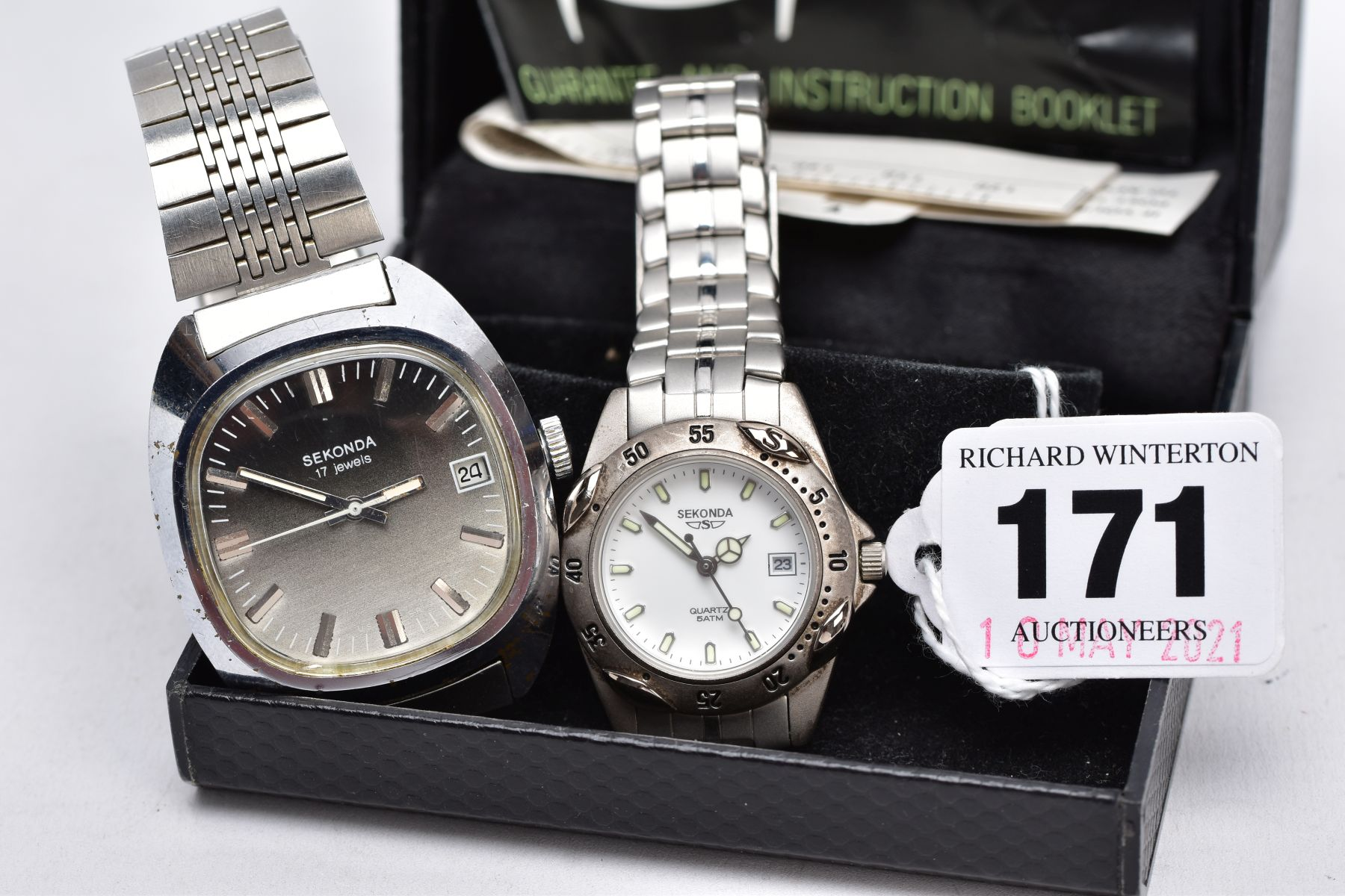 A LADIES AND A GENTS 'SEKONDA' WRISTWATCH, gents hand wound watch with a cushion shaped ombre silver
