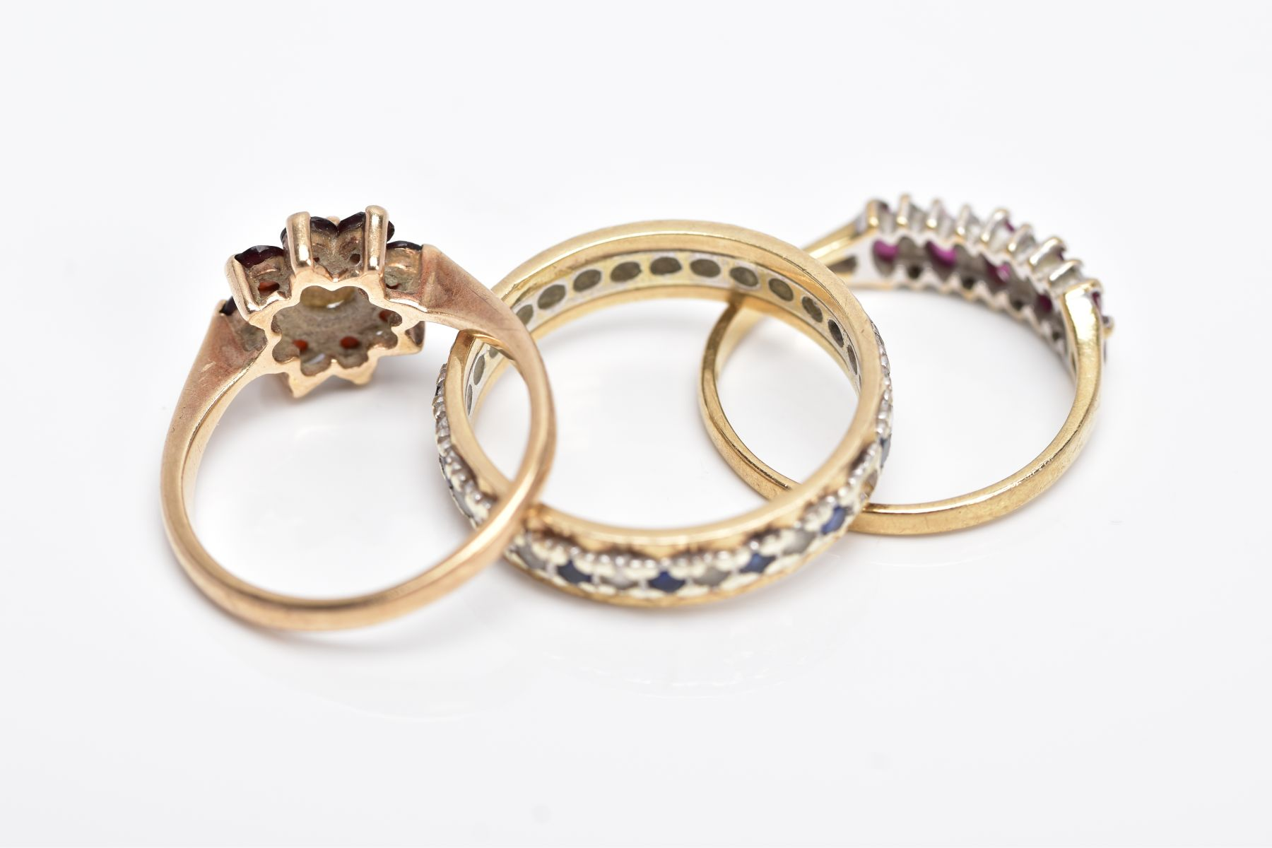 THREE 9CT GOLD GEM SET RINGS, to include a full eternity ring set with colourless spinel and blue - Image 3 of 4
