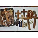 A BOX OF VARIOUS CRUCIFIXES, some metal, mostly resin, mostly wall hangings, tallest height 36cm,