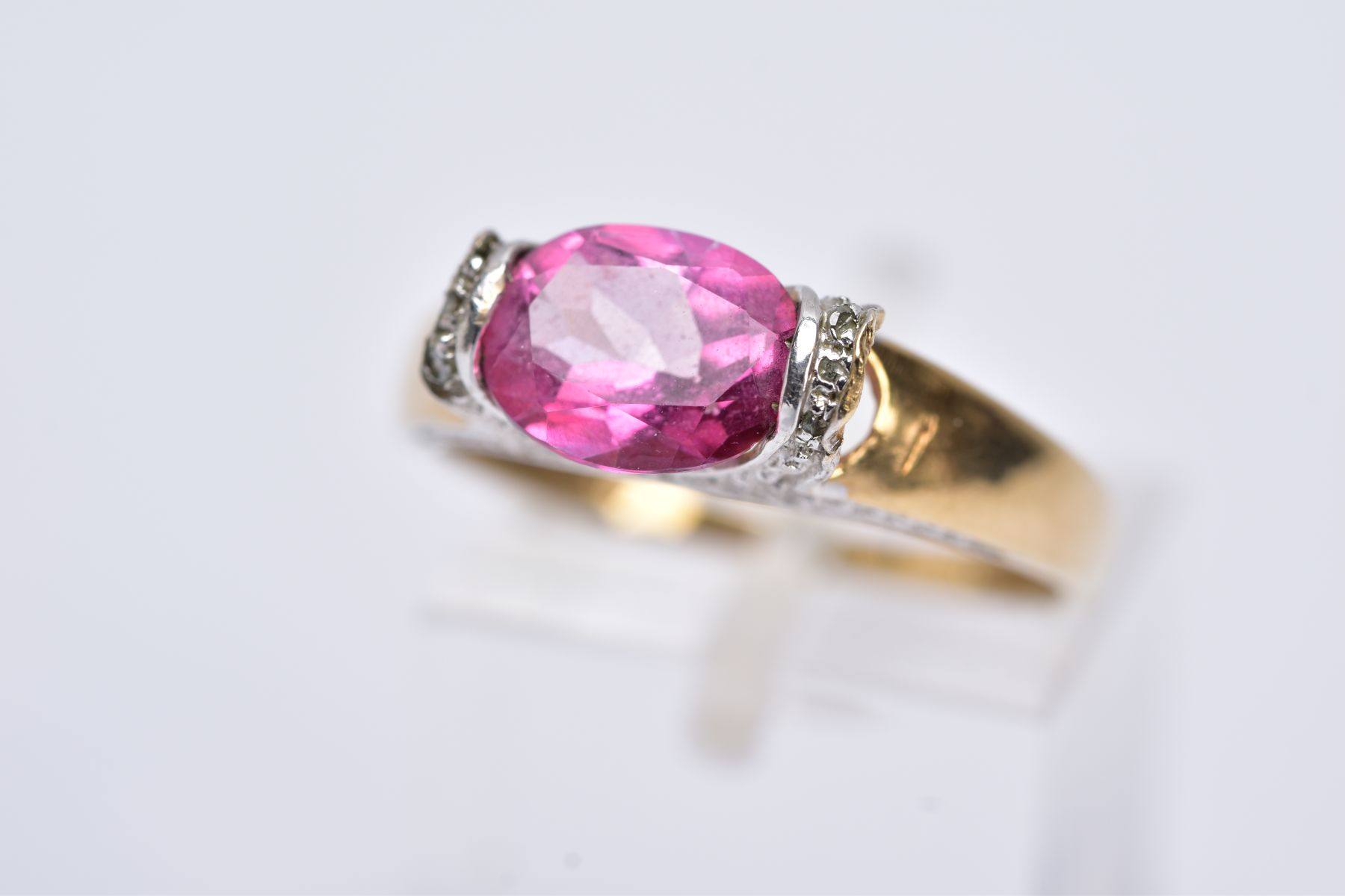 A 9CT GOLD PINK TOPAZ RING, designed with a tension set, oval cut pink topaz, single cut diamond - Image 2 of 5