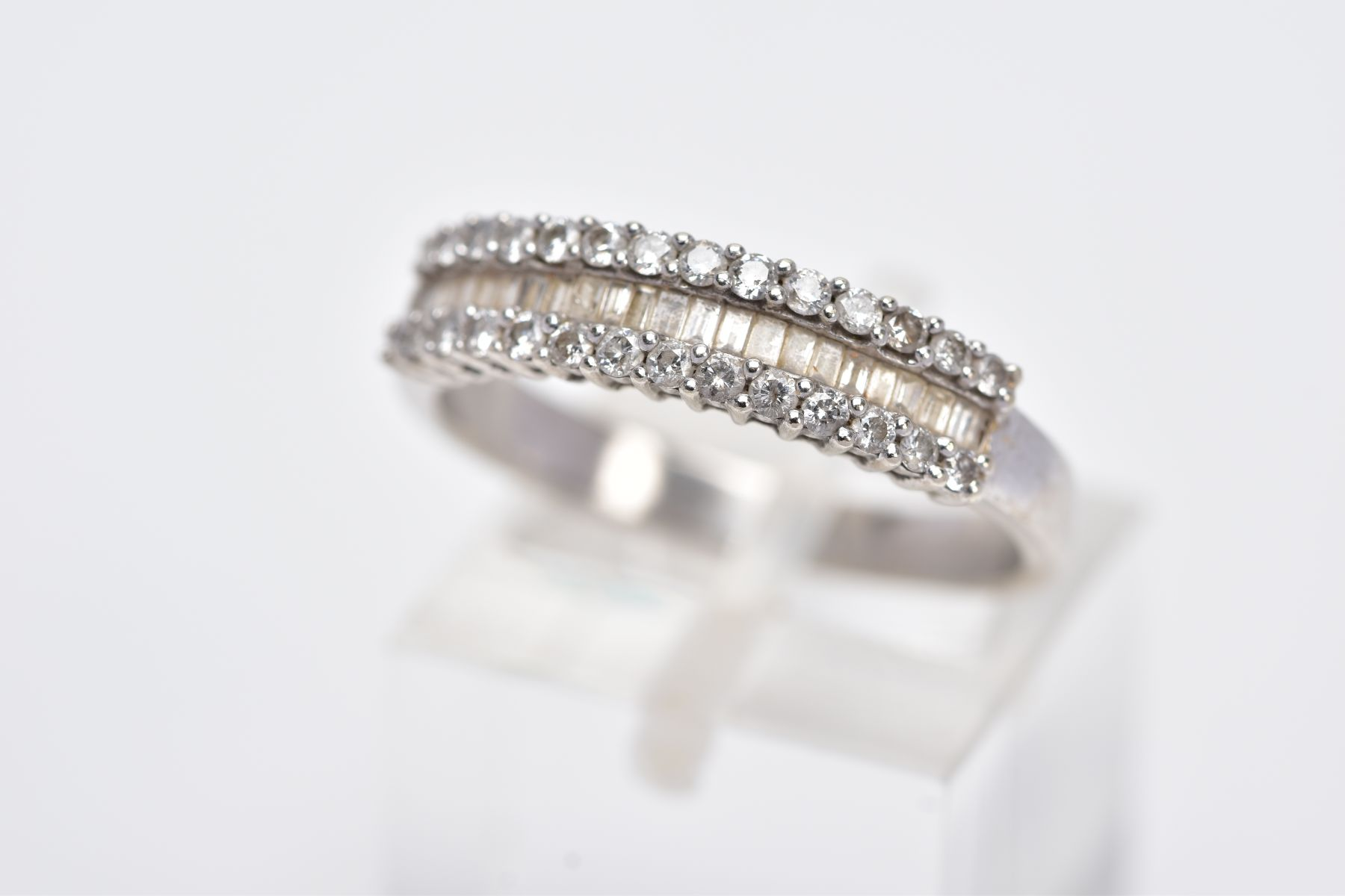 A 9CT WHITE GOLD HALFHOOP DIAMOND RING, designed with a central row of rectangular cut diamonds