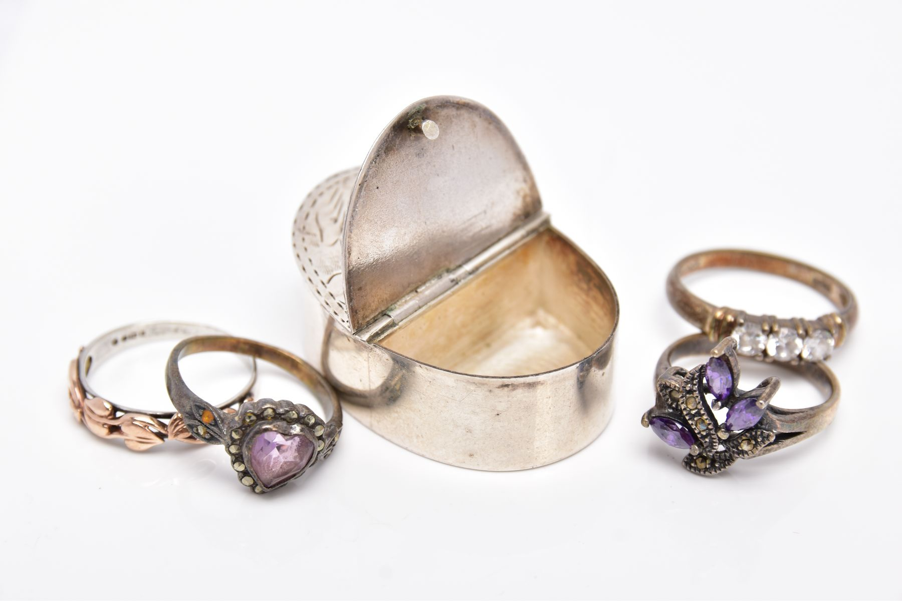 A SILVER PILL BOX, A SILVER RING AND THREE WHITE METAL RINGS, the pill box of an oval form has two - Image 4 of 4