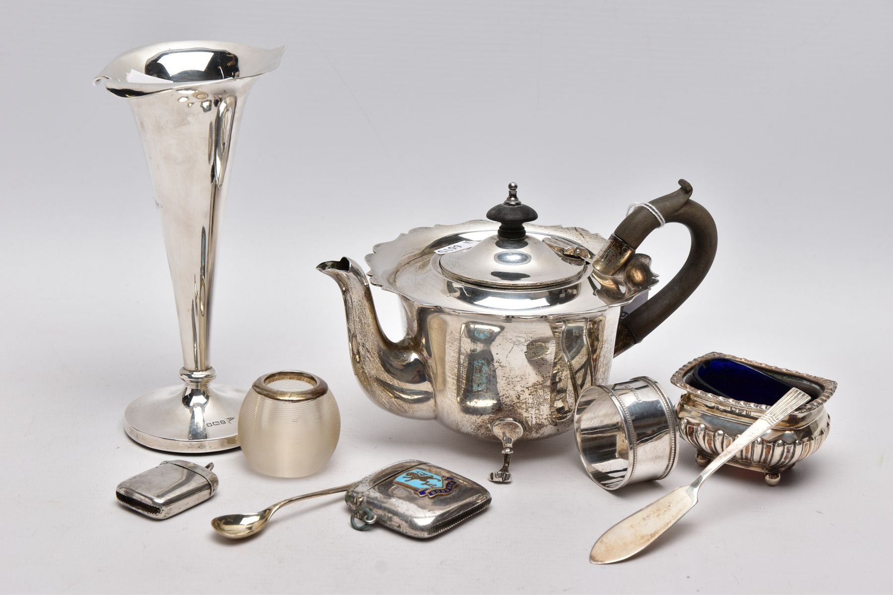 A SELECTION OF SILVER AND WHITE METAL ITEMS, to include an early 20th century AF silver teapot, wavy