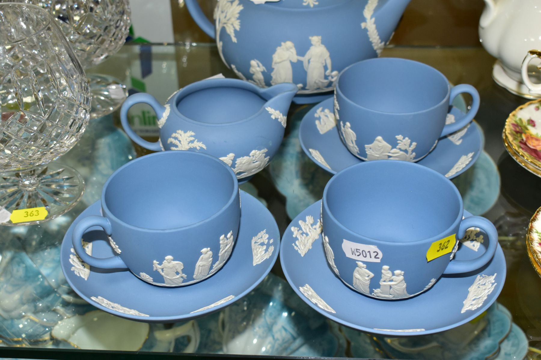 A SMALL COLLECTION OF WEDGWOOD PALE BLUE JASPERWARE, comprising a tea pot and cover and flattened - Image 2 of 6