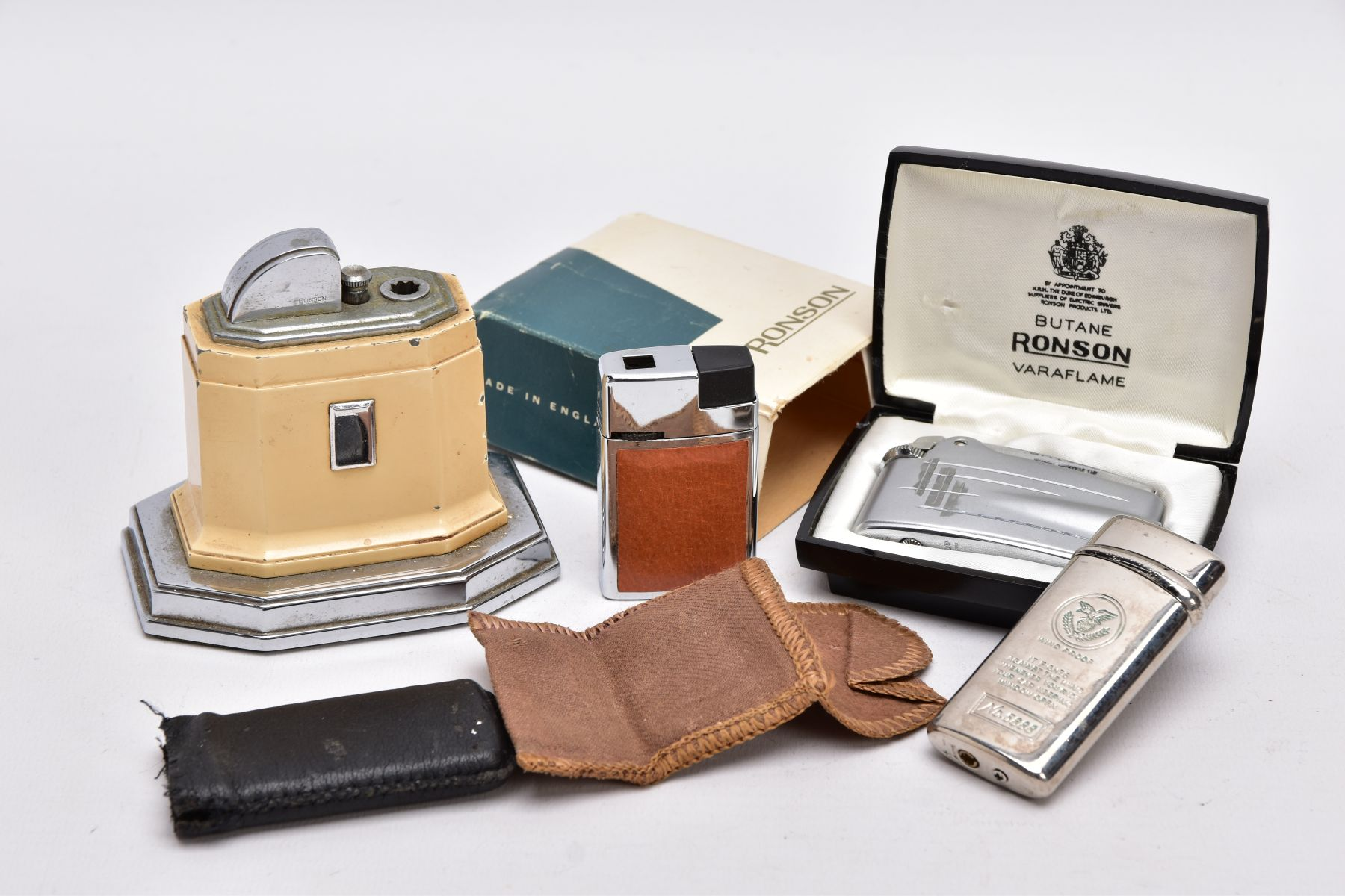 A 'RONSON' TOUCH TIP TABLE LIGHTER, A BOXED 'RONSON' LIGHTER AND TWO OTHERS, an art deco style cream