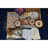 A BOX OF WOOLWORK, including three framed completed floral woolworks, a woolwork instruction