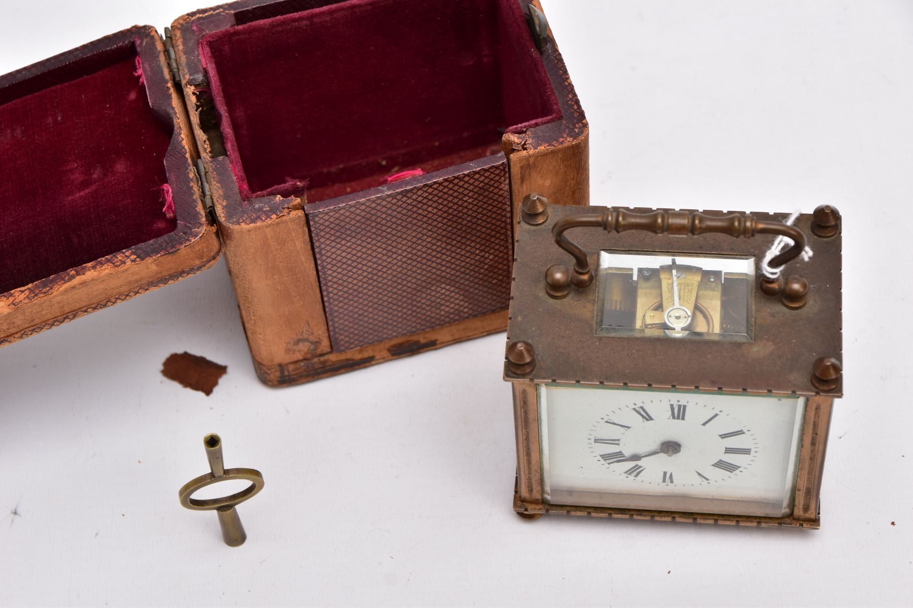 A SMALL LEATHER CASED BRASS TRAVEL CARRIAGE CLOCK, glass panels, white dial with roman numerals, - Image 2 of 8