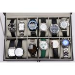 A WATCH DISPLAY CASE WITH WATCHES, a black and glass panelled watch display case, with twelve