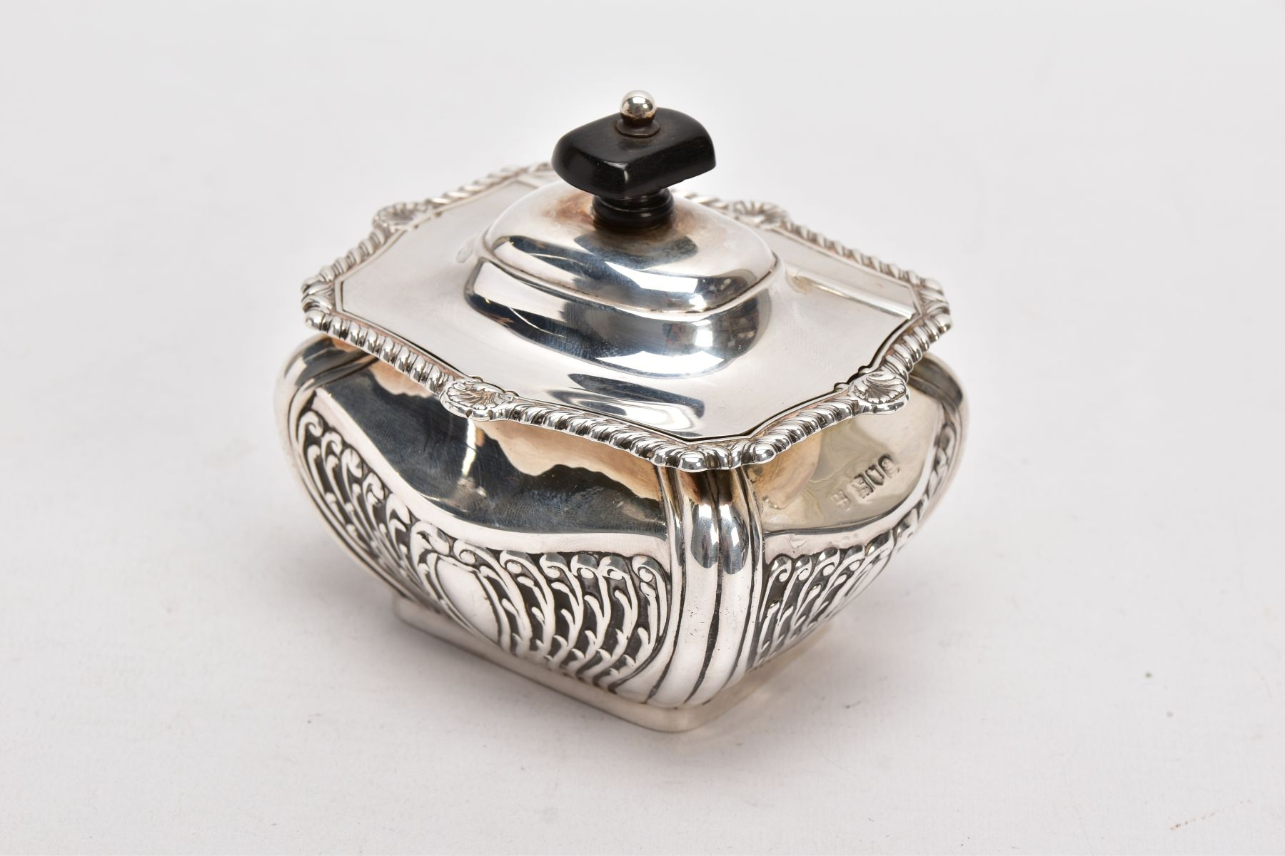 AN EDWARDIAN SILVER TEA CADDY, bomb shaped sucrier with hinged cover, gadrooned and shell cast