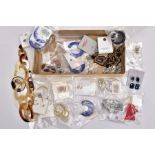 A TRAY OF COSTUME JEWELLERY, some pieces with tags and packaging, to include a large resin hoop