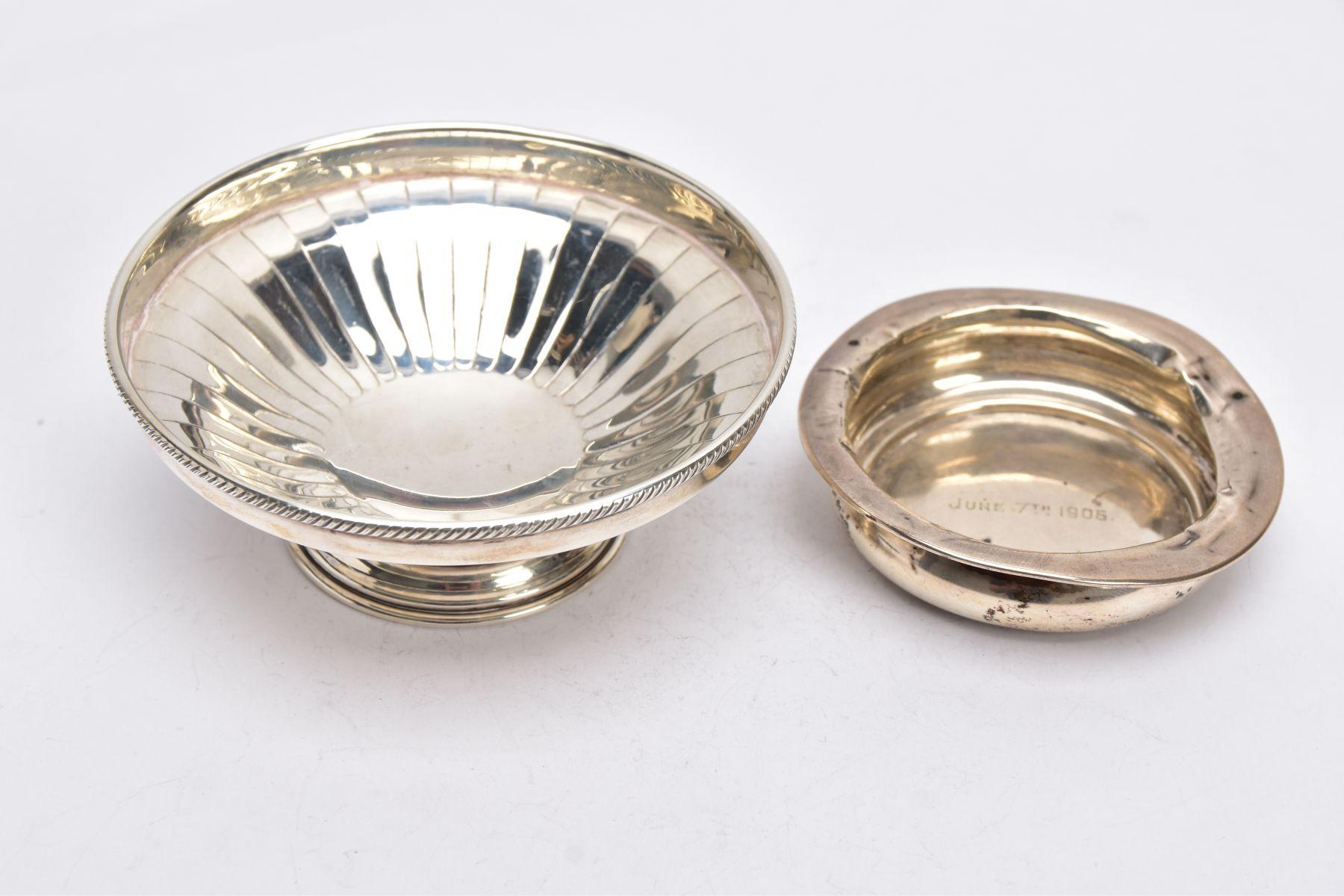 A SILVER BONBON DISH AND A SILVER DISH, the bonbon of a circular form, tapered engraved design,