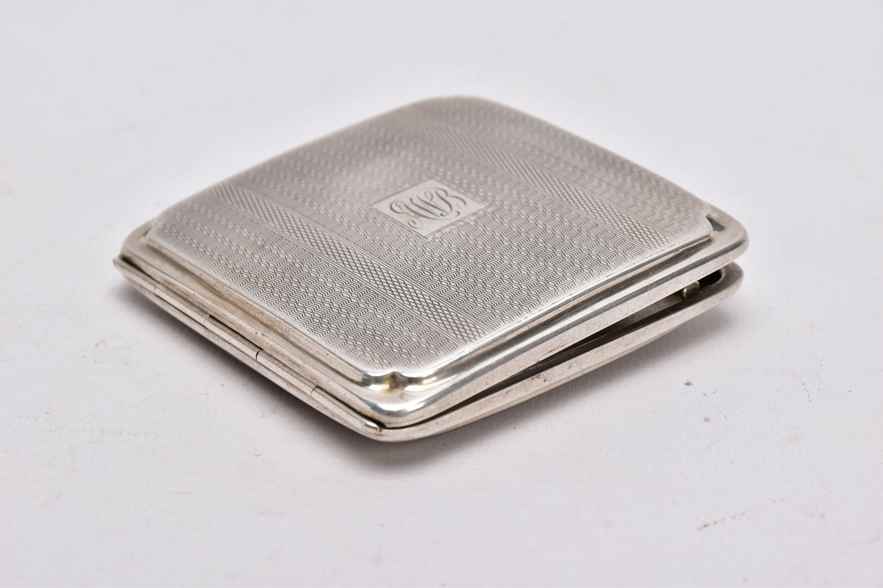 A SILVER CIGARETTE CASE, of an engine turn design, engraved monogram, missing elastic straps on - Image 3 of 3