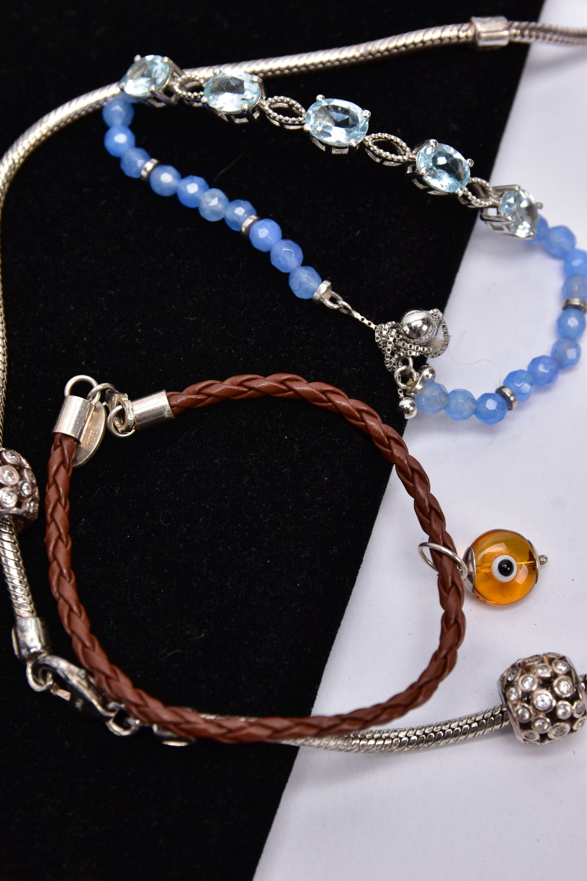 FOUR BRACELETS AND NECKLET, to include a white metal slider bracelet set with five oval cut blue - Image 3 of 4