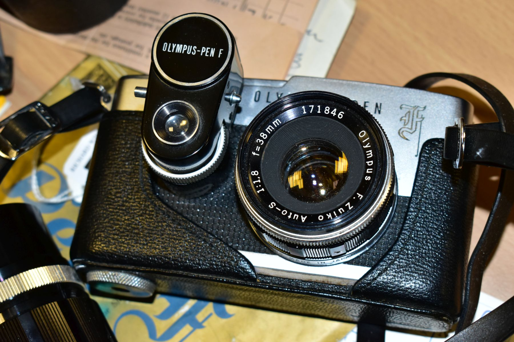 AN ORIGINAL OLYMPUS F HALF FRAME FILM CAMERA fitted with a 38mm f1.8 Olympus Zuiko lens and F T - Image 8 of 11