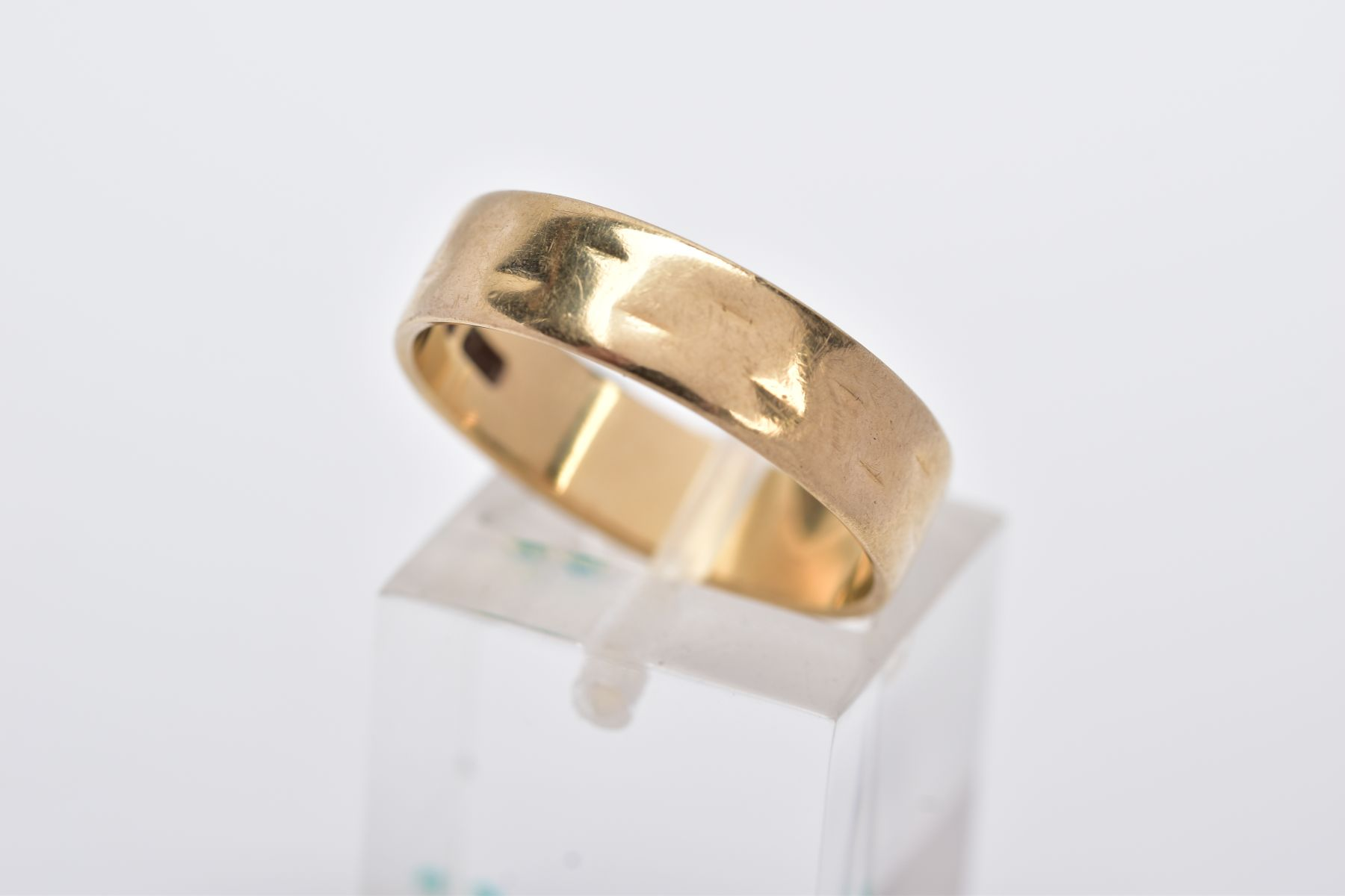 A 9CT GOLD WIDE BAND, slight textured effect, approximate width 5.5mm, hallmarked 9ct gold London,