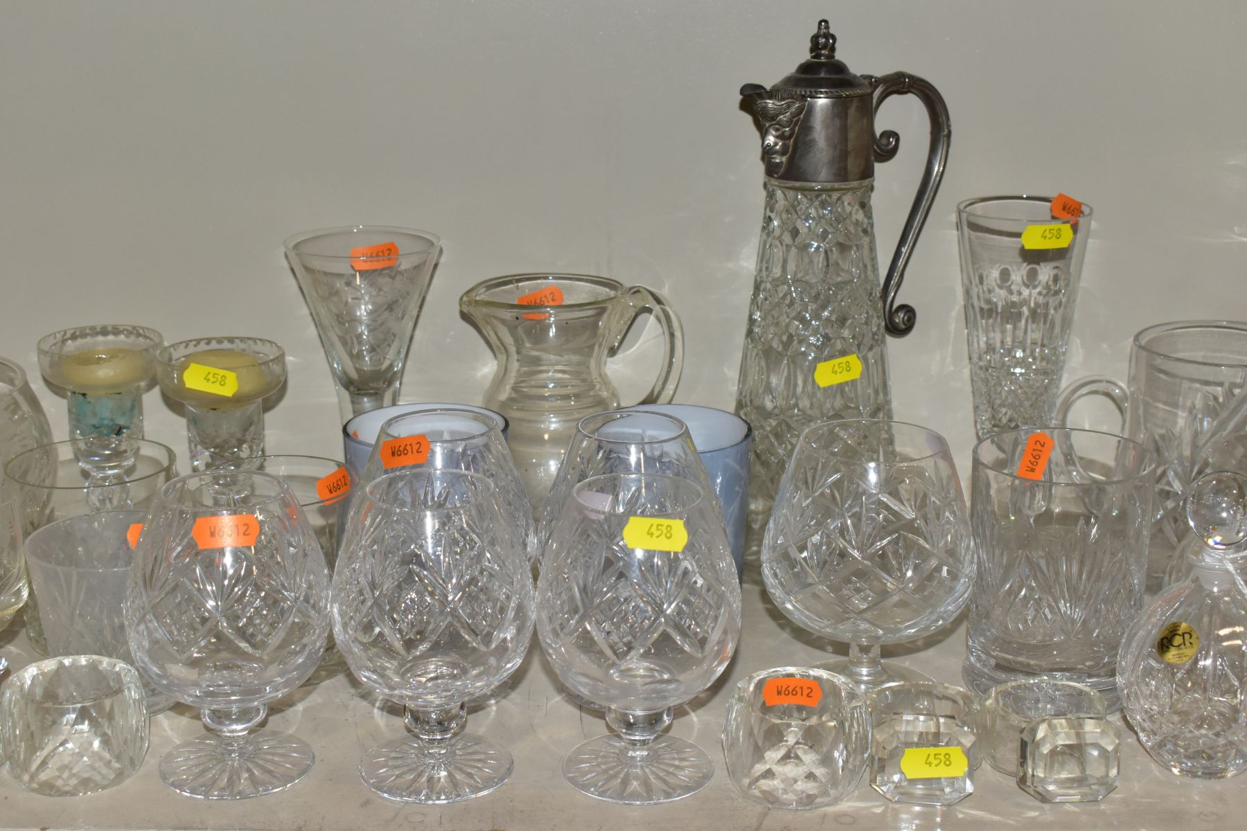 A SMALL QUANTITY OF CLEAR AND COLOURED GLASSWARE, including an Edinburgh Crystal vase, height 25.