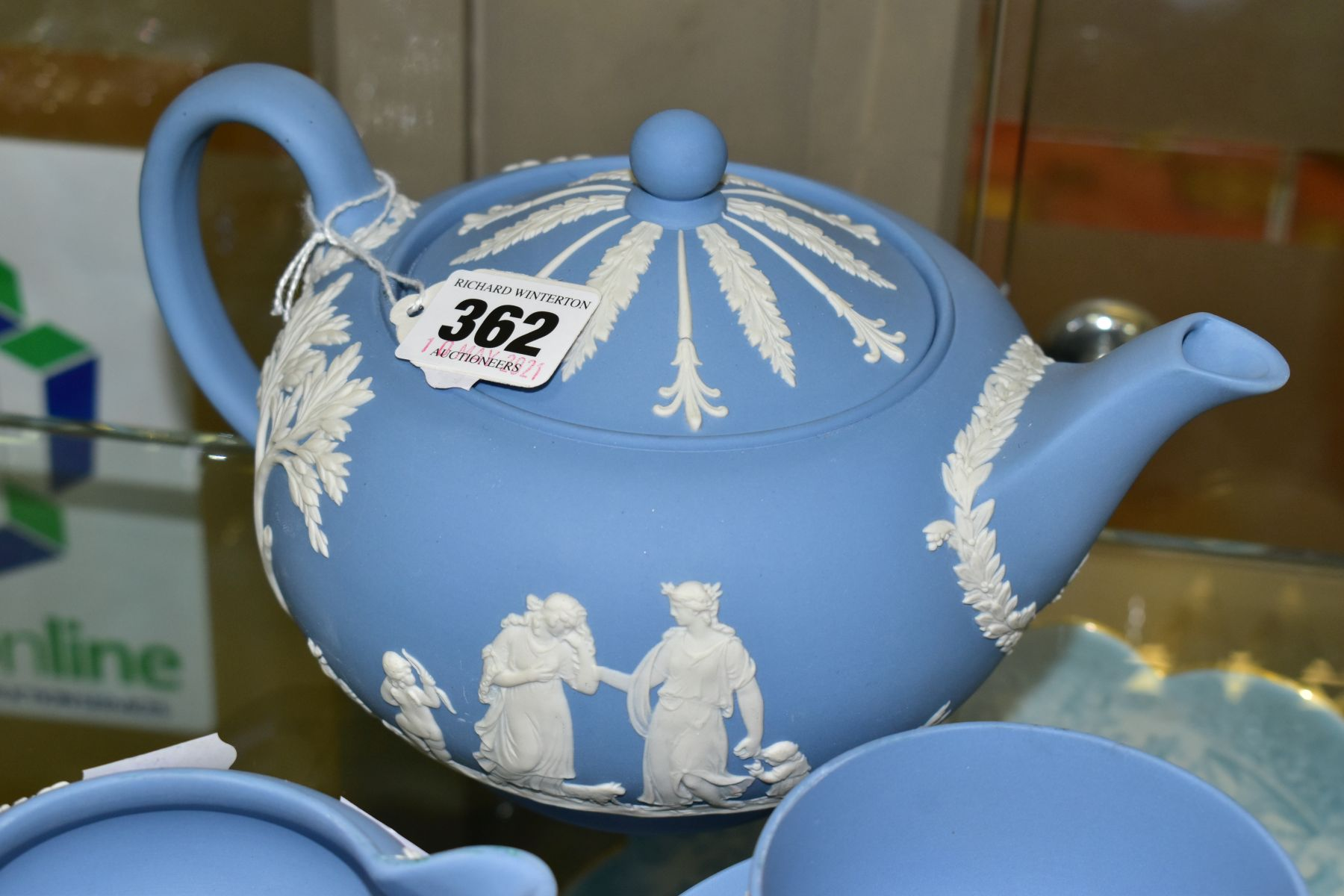 A SMALL COLLECTION OF WEDGWOOD PALE BLUE JASPERWARE, comprising a tea pot and cover and flattened - Image 3 of 6