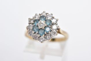 A 9CT GOLD DRESS RING, tiered cluster set with circular cut colourless stones assessed as paste,
