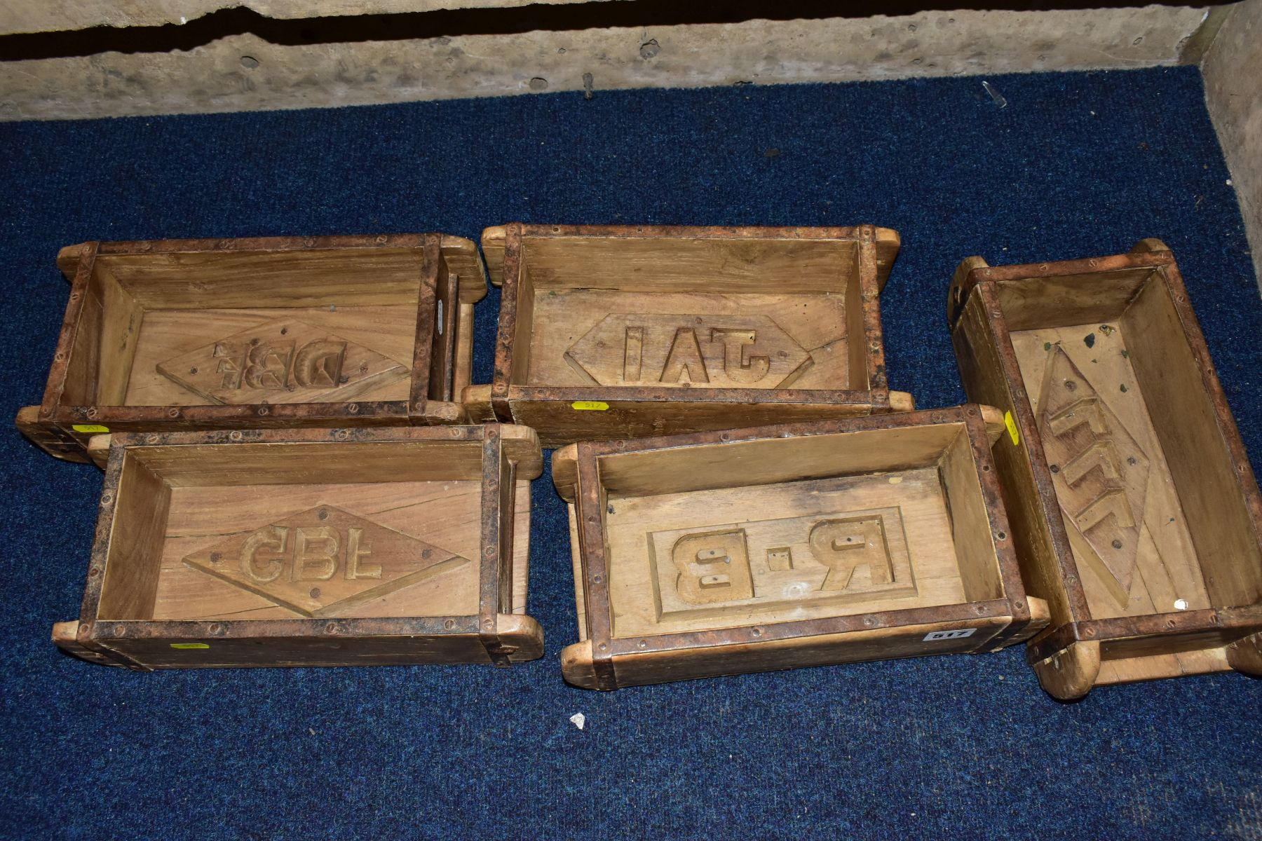 FIVE WOODEN AND METAL BOUND BRICKMAKERS MOULDS, all five with initials/numbers to the interiors,