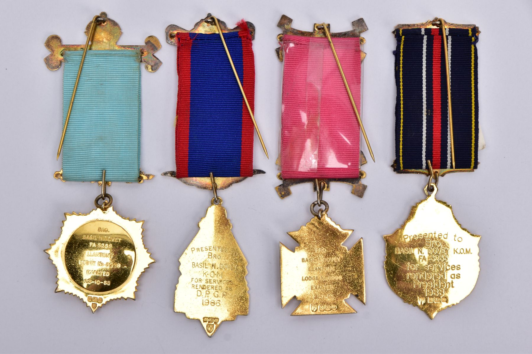 FOUR SILVER GILT, MASONIC MEDALS, of various designs decorated with blue, red, green and white - Image 2 of 2