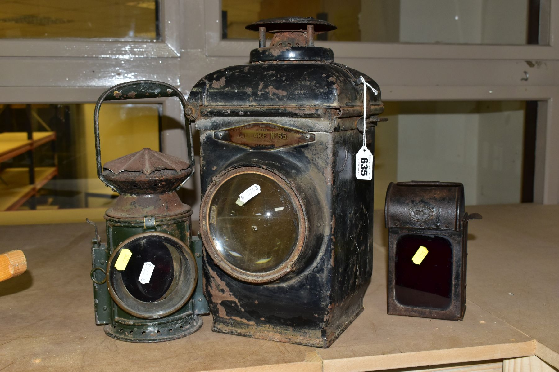 AN ADLAKE NO. 55 RAILWAY LAMP, black painted body with clear bulls eye lens, complete with lift