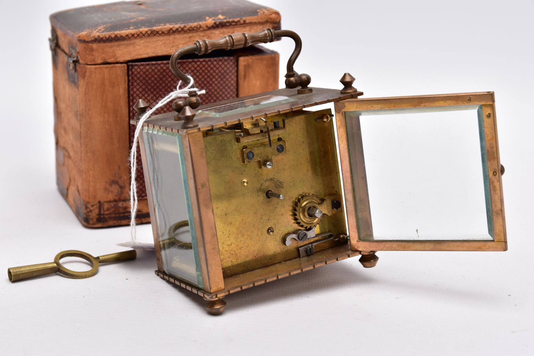 A SMALL LEATHER CASED BRASS TRAVEL CARRIAGE CLOCK, glass panels, white dial with roman numerals, - Image 4 of 8