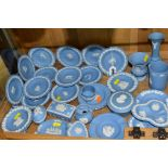 WEDGWOOD BLUE JASPERWARE TRINKETS AND VASES, etc, to include a set of twelve dishes from Zodiac