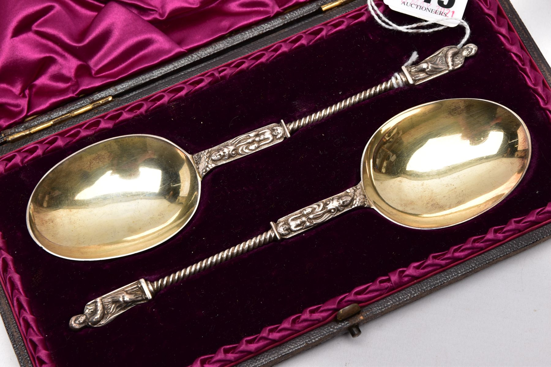 A CASED TWO PIECE LATE VICTORIAN SILVER GILT SPOON SET, brown case opens to reveal a purple velvet - Image 2 of 4
