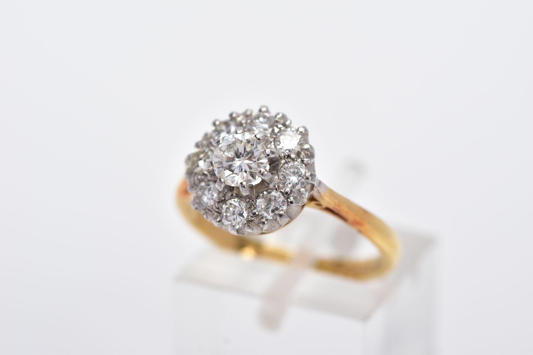 A LATE 20TH CENTURY ROUND DIAMOND CLUSTER RING, centring on a modern round brilliant cut diamond,