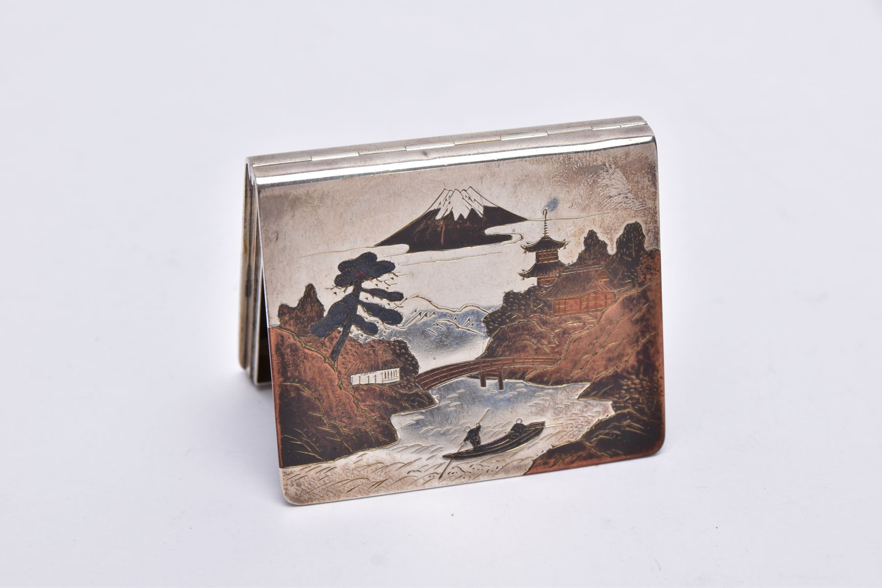 A WHITE METAL JAPANESE STYLE BOX, hinged square box, depicting a tri-coloured oriental river and