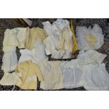 A BOX OF VINTAGE BABY AND TODDLERS CLOTHING ETC, mostly white and cream in colour, to include