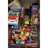 A QUANTITY OF ASSORTED TOYS AND GAMES, to include modern Action Man figures, Transformers, battery