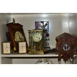 SIX CLOCKS COMPRISING A GERMAN ANNUAL ANNIVERSARY CLOCK, two Rapport of London carriage clocks,
