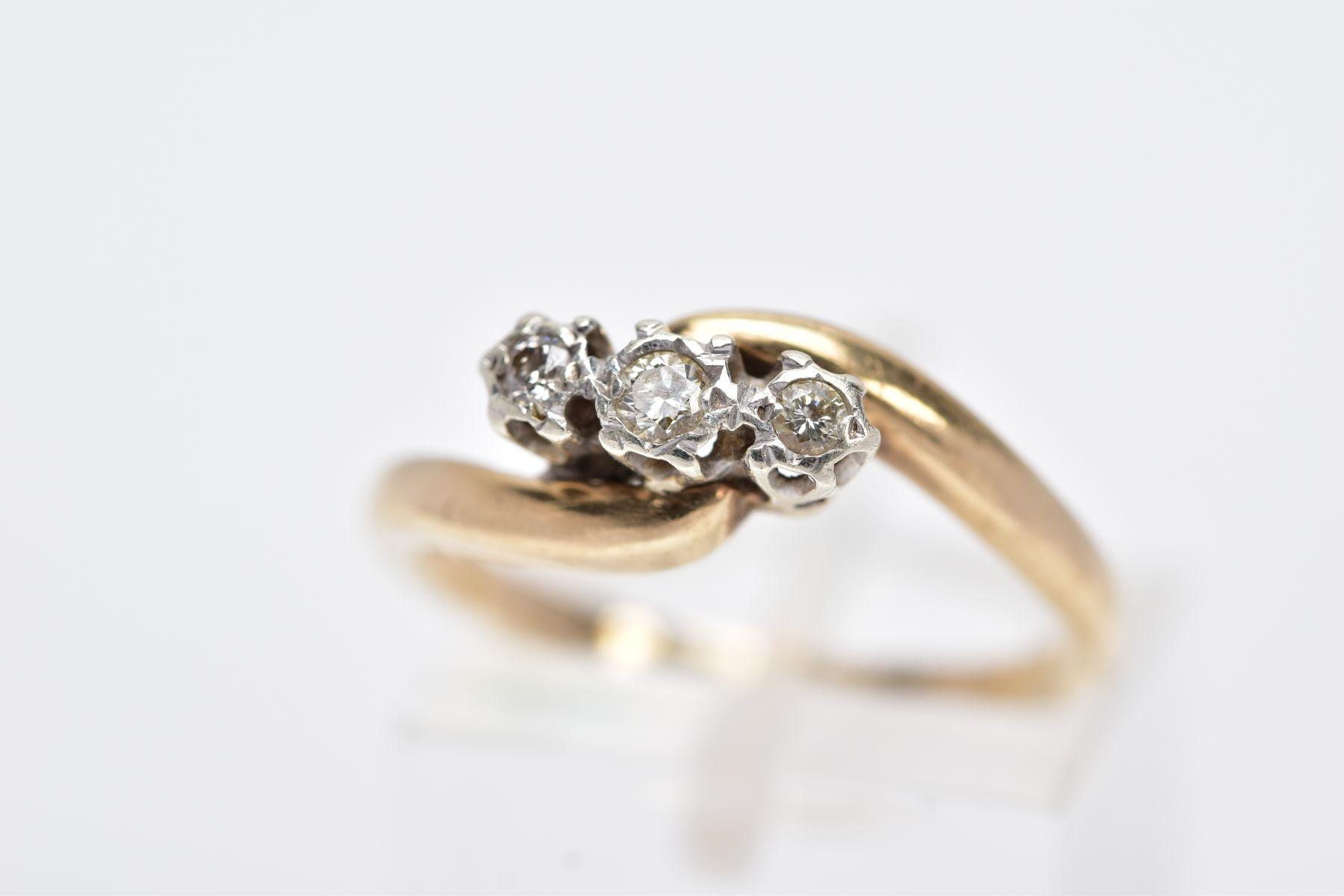 A 9CT GOLD THREE STONE DIAMOND RING, designed with three graduated round brilliant cut diamonds,