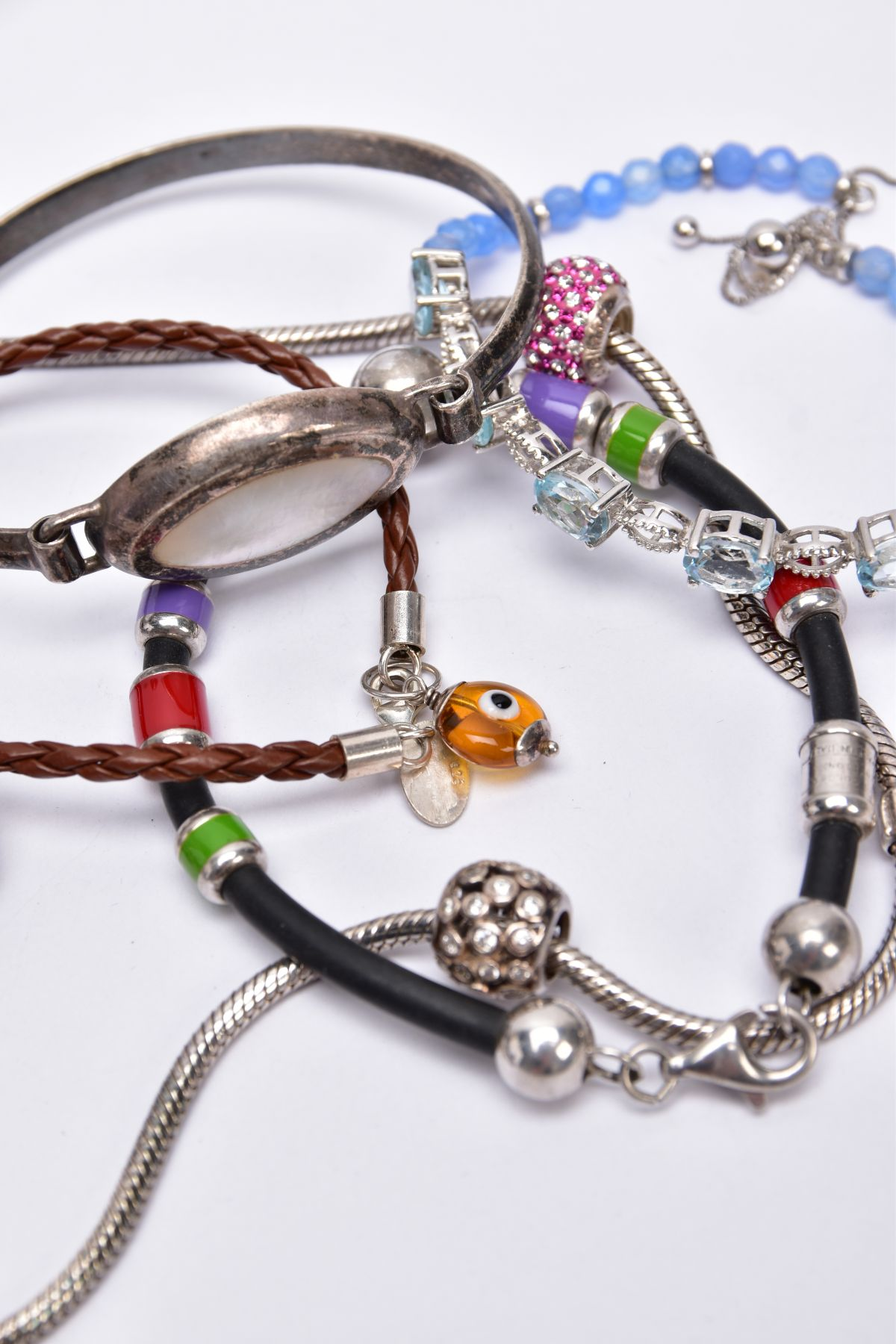 FOUR BRACELETS AND NECKLET, to include a white metal slider bracelet set with five oval cut blue - Image 4 of 4