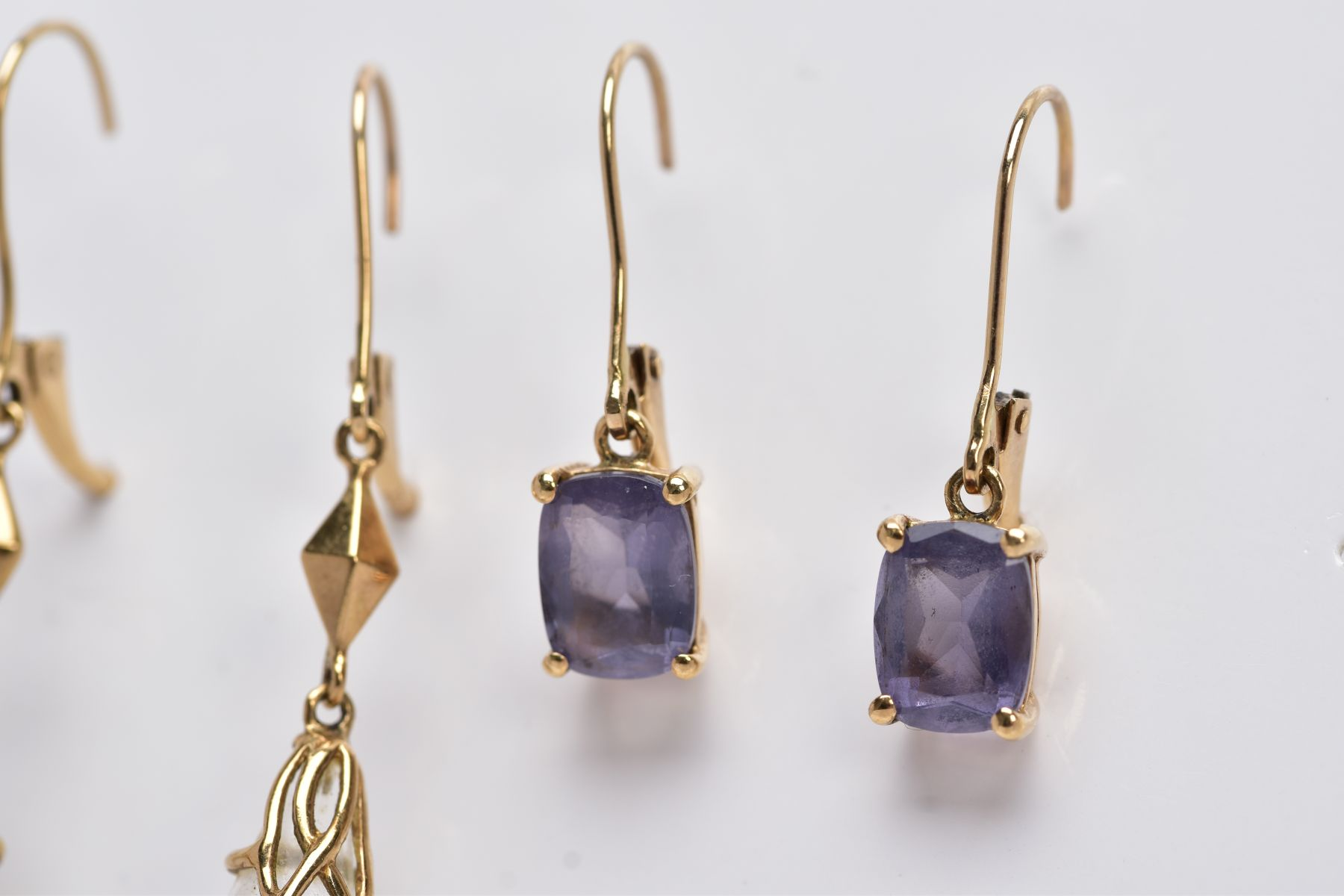 TWO PAIRS OF YELLOW METAL GEMSET DROP EARRINGS, the first pair suspending claw set, oval cut - Image 2 of 4