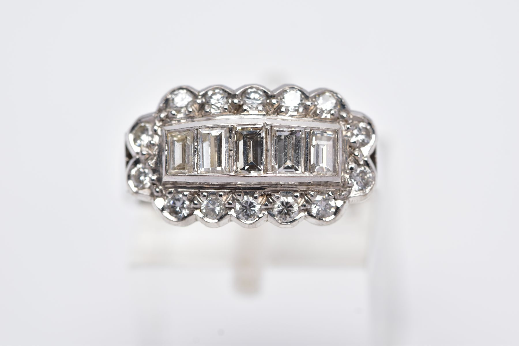 A LATE 20TH CENTURY 18CT WHITE DIAMOND DRESS RING, comprising five trap cut diamonds each - Image 5 of 5