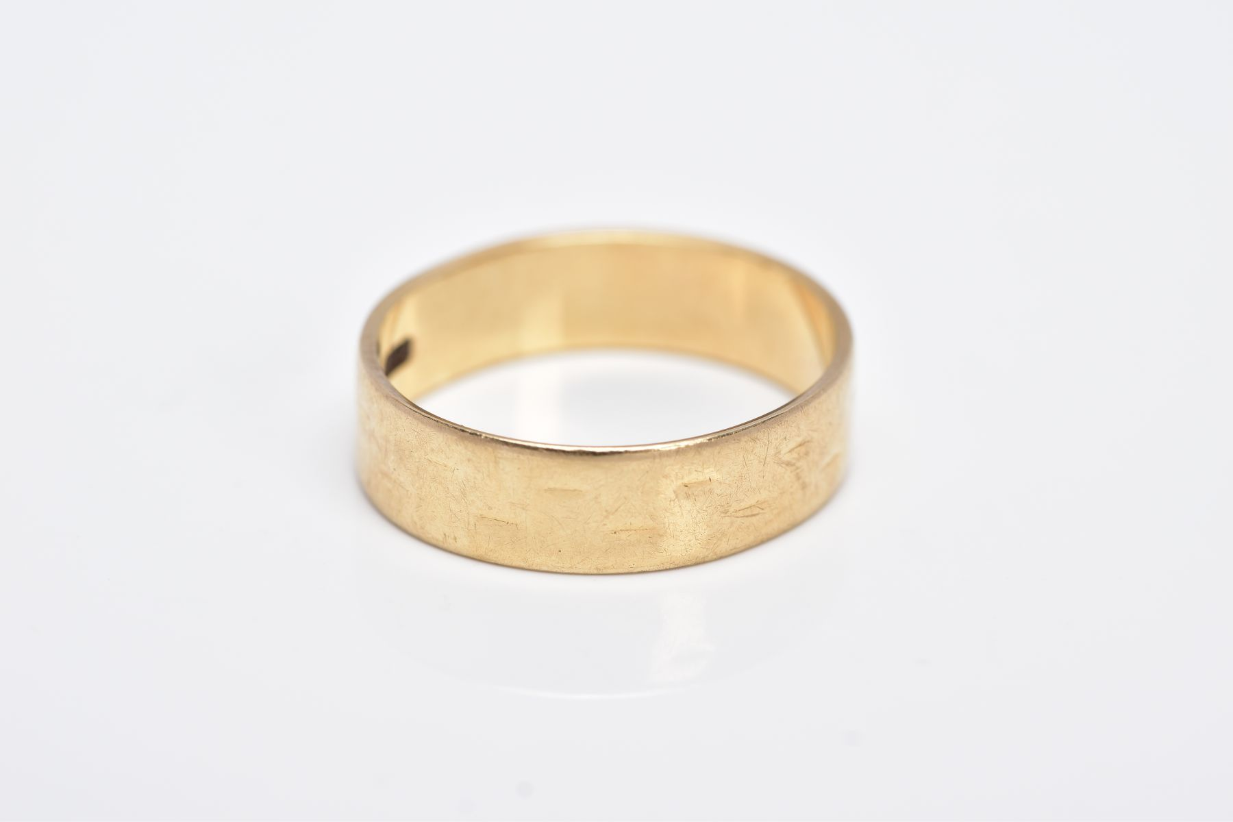 A 9CT GOLD WIDE BAND, slight textured effect, approximate width 5.5mm, hallmarked 9ct gold London, - Image 2 of 2