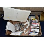 A BOX OF GAMING ITEMS, to include Wii console and Wii fit board and game, various other games (