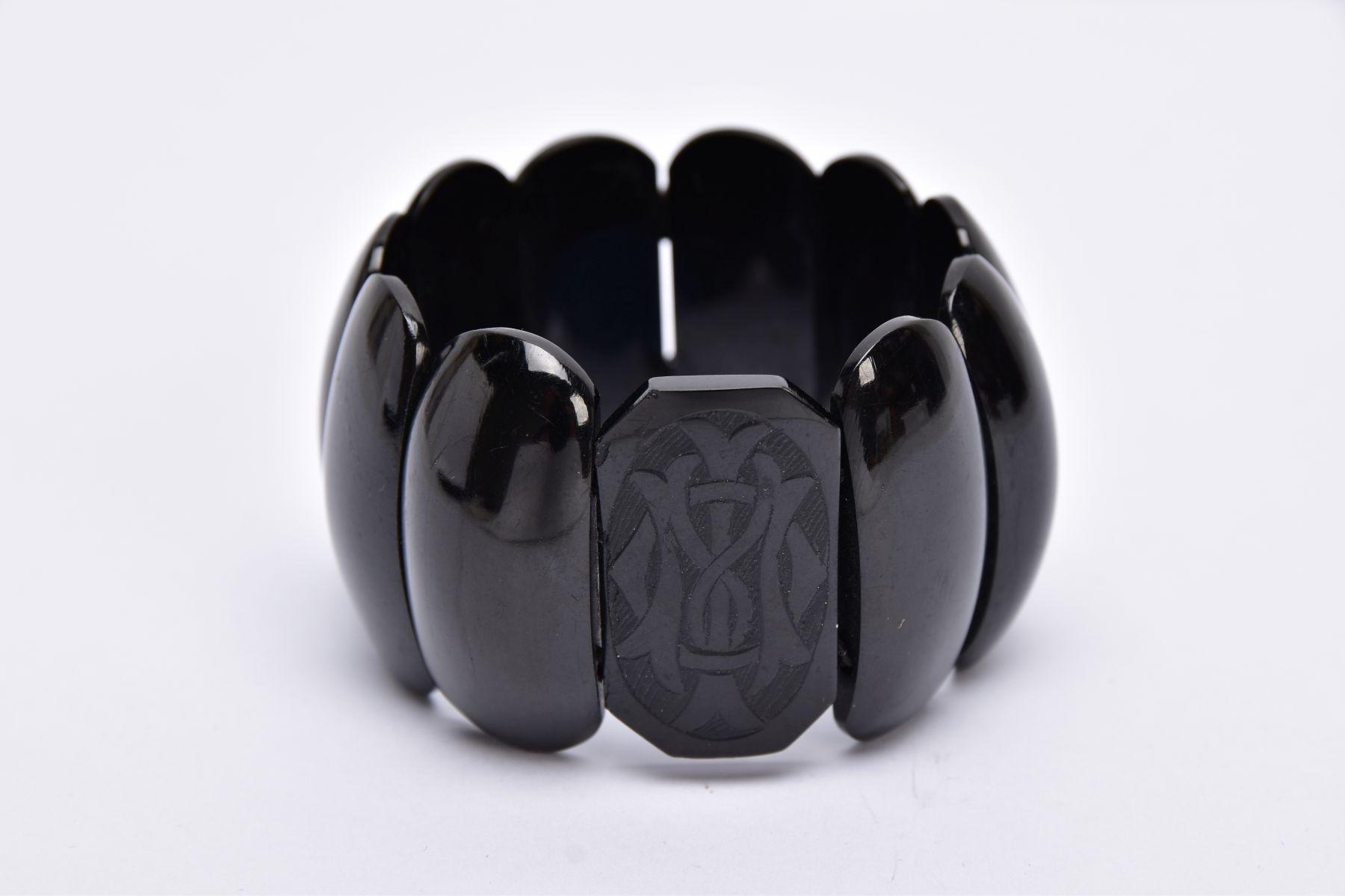 A VICTORIAN JET BRACELET, stretch bracelet, one rectangular shaped link with an engraved monogram,
