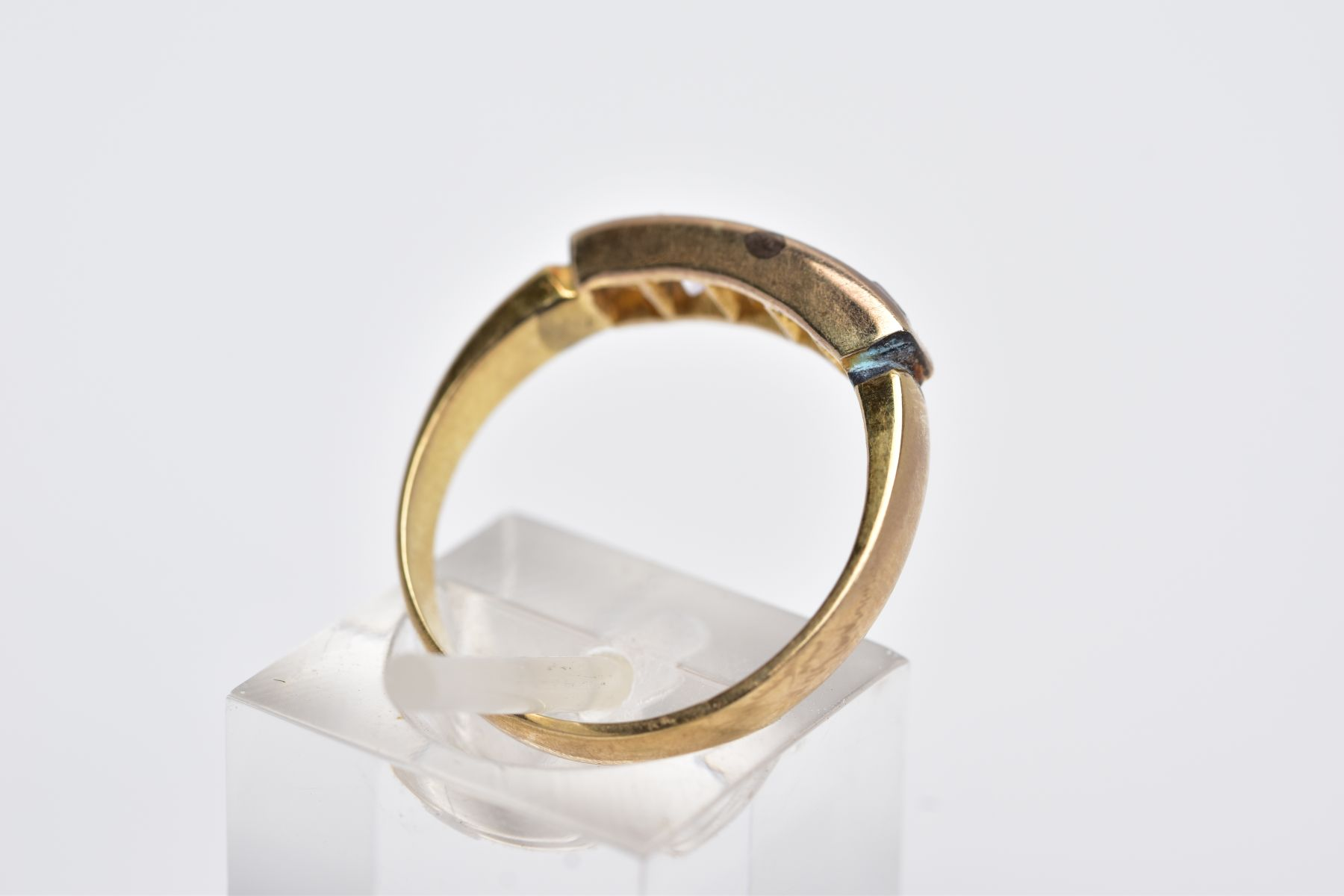 A YELLOW METAL HALF HOOP RING, designed with a row of graduated square cut colourless stones, - Image 3 of 4