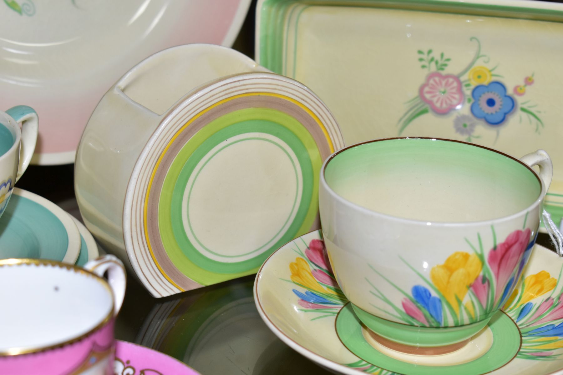 CLARICE CLIFF, comprising a Crocus pattern tea cup and saucer, backstamps for Royal Staffordshire - Image 6 of 10