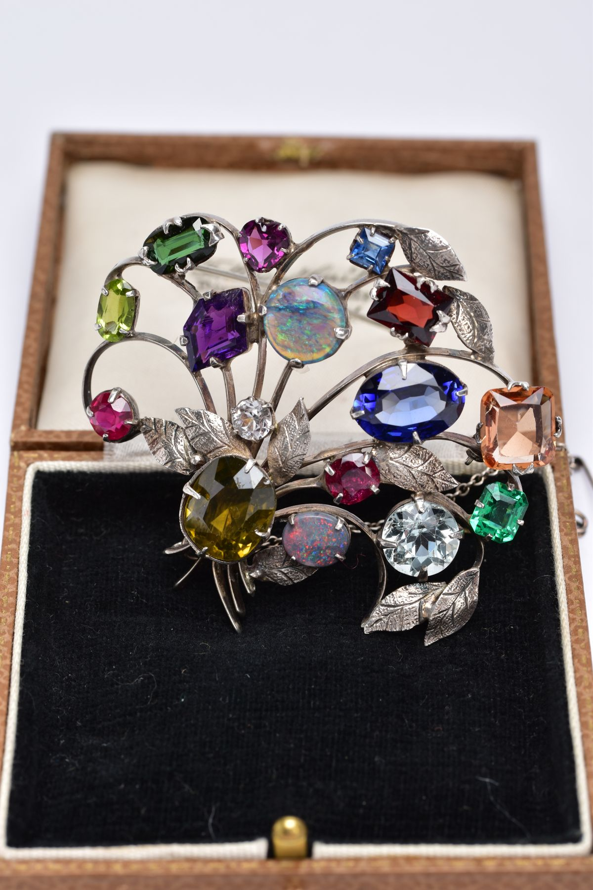 A WHITE METAL FLORAL SPRAY, GEM SET BROOCH, floral spray set with a variety of multi cut gemstones - Image 3 of 5