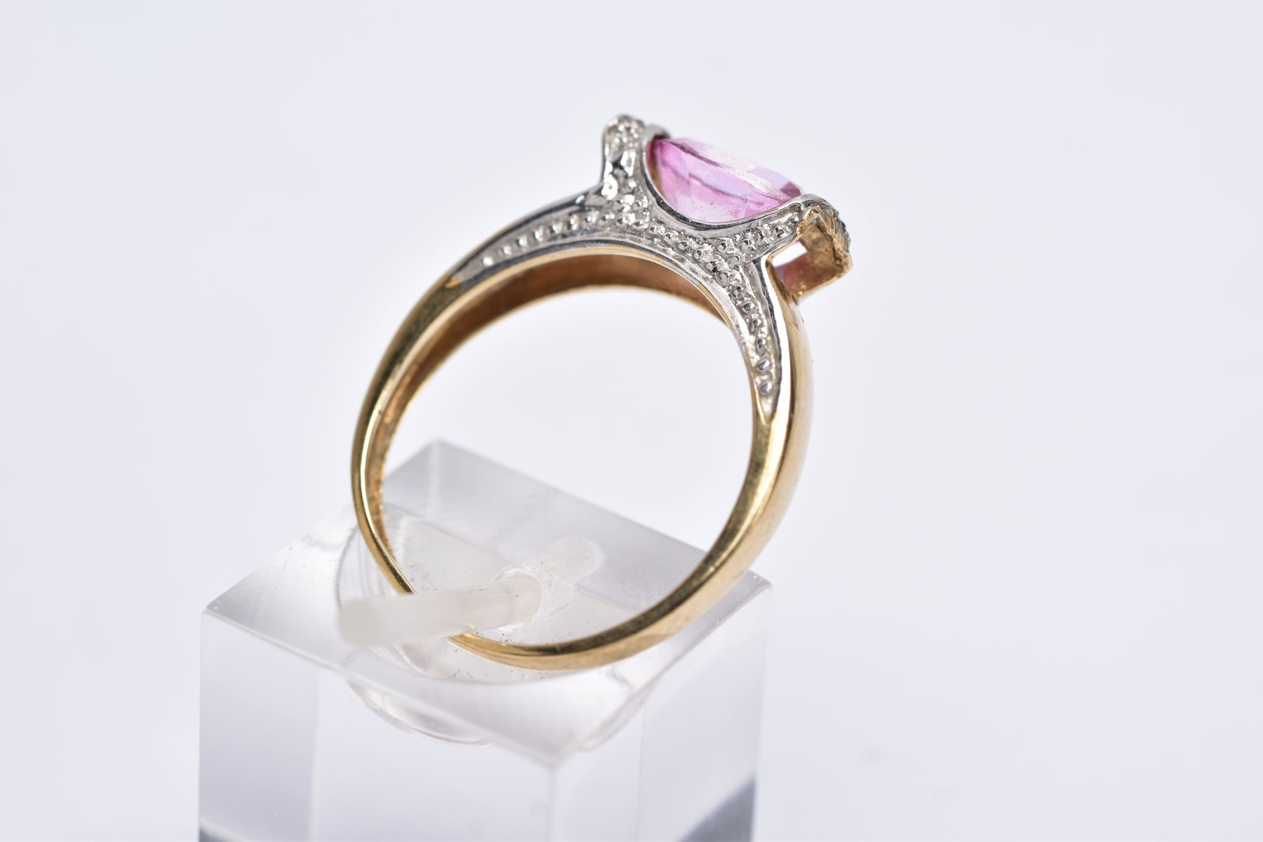 A 9CT GOLD PINK TOPAZ RING, designed with a tension set, oval cut pink topaz, single cut diamond - Image 4 of 5